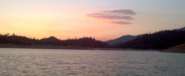 A boat dock at sunset on Lake Shasta